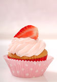 Vanilla cupcake with stawberry frosting Royalty Free Stock Photography