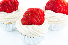 Vanilla cupcake with strawberry frosting and fresh strawberry Royalty Free Stock Photo