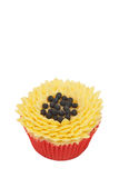 Vanilla cupcake with sunflower decoration. Fresh vanilla cupcake with sunflower buttercream icing decoration on white background Royalty Free Stock Photography