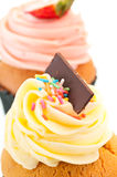 Vanilla cupcake topping vertical close up Royalty Free Stock Image