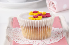 Vanilla cupcake with white icing Stock Images
