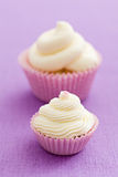 Vanilla cupcakes with buttercream topping Stock Photo