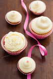 Vanilla cupcakes with buttercream topping Stock Images