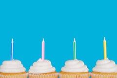 Vanilla cupcakes with candles Royalty Free Stock Photos