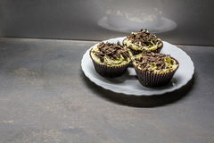 Vanilla cupcakes. With cream sprinkled with chocolate Stock Images