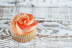 Vanilla cupcakes decorated with a red rose from a cream on a white background Stock Photography