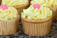 Vanilla Cupcakes with Lemon Icing Royalty Free Stock Photography