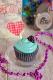 Vanilla cupcakes with mint cream for Valentine`s Day. Festive cupcakes vanilla cupcakes with mint cream Stock Images