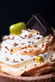Vanilla cupcakes with orange and white creamcheese and chocolate. Decor. Selective focus. Shallow depth of field stock images