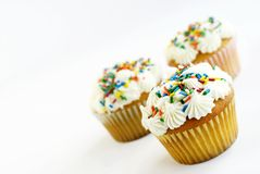Vanilla Cupcakes with Sprinkles Stock Photo