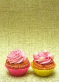 Vanilla cupcakes with strawberry icing Royalty Free Stock Image