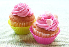 Vanilla cupcakes with strawberry icing Royalty Free Stock Images