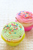 Vanilla cupcakes with strawberry and lime icing Royalty Free Stock Photo