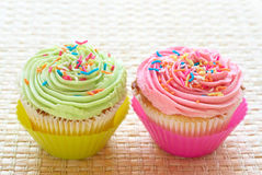 Vanilla cupcakes with strawberry and lime icing Royalty Free Stock Photography