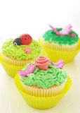 Vanilla cupcakes with various decorations. Vanilla cupcakes with buttercream icing and various decorations Stock Image