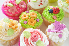 Vanilla cupcakes with various decorations. Vanilla cupcakes with buttercream icing and various decorations Stock Images