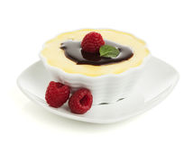 Vanilla custard, chocolate topping, raspberries Royalty Free Stock Photos
