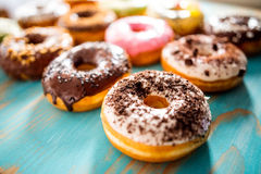 Vanilla donut with cocoa powder Royalty Free Stock Images