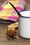 Vanilla in enamel cup Stock Image