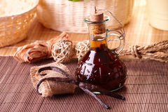 Vanilla extract and beans. Vanilla extract with beans with nice decoration Royalty Free Stock Photo
