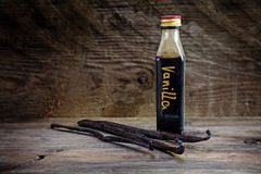 Vanilla extract, homemade in a small bottle and vanilla beans on Royalty Free Stock Images