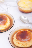 Vanilla flan. Flan: Sweet custard with a caramel topping. Pudding. Vanilla flavor. Crème caramel, known as flan in the US and Spanish speaking countries, and Royalty Free Stock Images