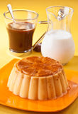 Vanilla flan. With coffee and milk, on yellow tablecloth Royalty Free Stock Photos