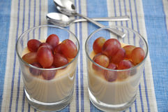 Vanilla Flan with grapes Stock Images