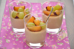 Vanilla Flan with grapes. Dessert with vanilla pudding and grapes royalty free stock photo