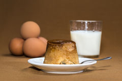 Vanilla flan and spoon. With elements on background Stock Photo