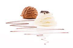 Vanilla flavor ice cream with chocolate crumbles in front of chocolate ice cream Stock Photography