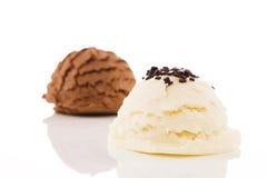 Vanilla flavor ice cream with chocolate crumbles in front of chocolate ice cream Stock Photos