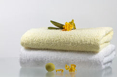 Fresh. Vanilla flowers decorate soft, scented towels Stock Photography