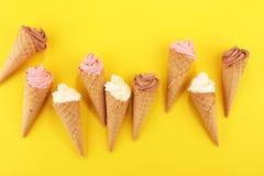 Vanilla frozen yogurt or soft ice cream in waffle cone. Vanilla frozen yogurt or soft ice cream in waffle cone royalty free stock images