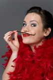 Vanilla girl. Girl in red plums with vanilla seedpod moustache Royalty Free Stock Images