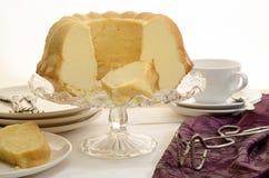 Vanilla gugelhupf on a glass cake stand Stock Photo