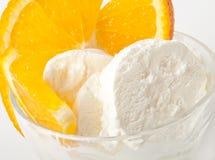Vanilla ice cream. With orange slices Royalty Free Stock Photography