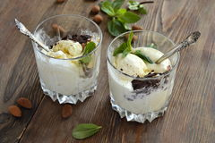 Vanilla ice cream with almond, mint  and chocolate chips. Selective focus Royalty Free Stock Photo