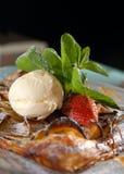 Vanilla ice-cream with a baked apple strudel Stock Photos