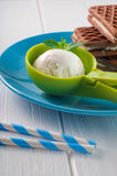 Vanilla ice cream ball in a green scoop Royalty Free Stock Photography