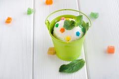 Vanilla ice cream ball in small bucket Stock Photo