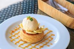 Vanilla ice cream, banana and crispy tart with caramel syrup Royalty Free Stock Photography