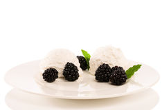 Vanilla ice cream with blackberries Stock Image