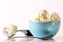 Vanilla ice cream in blue bowl Royalty Free Stock Images