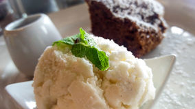 Vanilla ice cream and brownie. Vanilla ice cream with mint and brownie and sticky toffee Stock Images