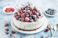 Vanilla ice cream cake with frozen berries Royalty Free Stock Image