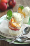 Vanilla ice cream with caramelized peaches Royalty Free Stock Image