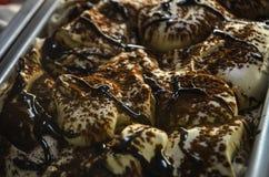 Vanilla ice cream with chocolate and cinnamon. Delicious vanilla ice cream with chocolate and cinnamon Stock Images