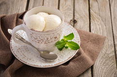 Vanilla ice cream in cup on rustic wooden background Royalty Free Stock Photography