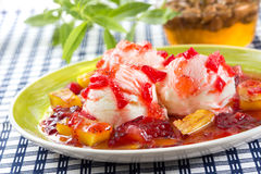 Vanilla ice cream with grilled fruits, plums, strawberries, pine Royalty Free Stock Photo